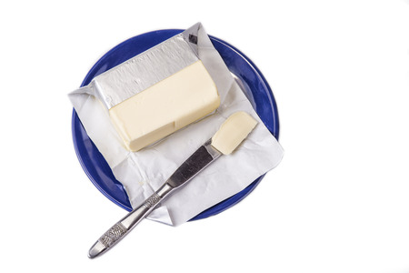 Butter on the blue plate  on the white background.