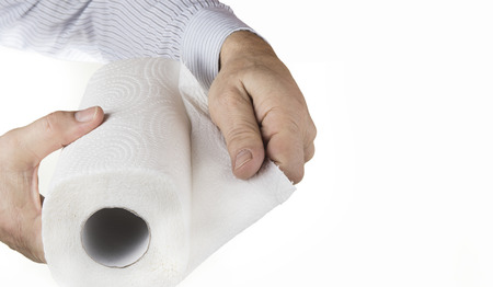 Kitchen paper towel with hand on the white background.