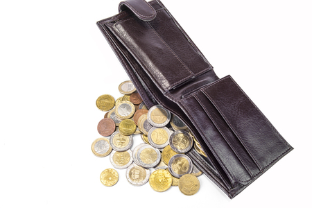 New wallet full of euro coins on white background