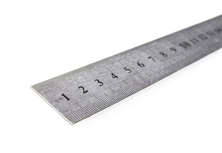 Metal ruler in centimeters or inches. Measuring tool on the white background