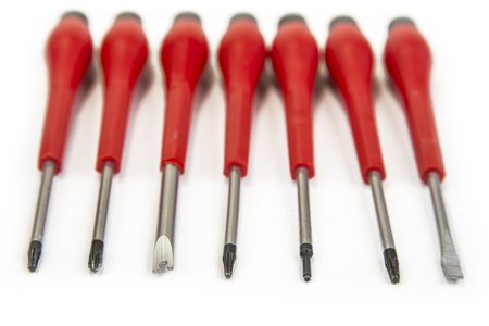 Set of pricise screwdrivers in the box on the white