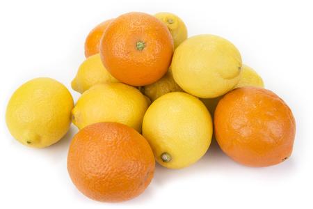 Fresh oranges and lemons on the white background Stock Photo