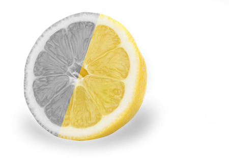 Black and white lemons and oranges friut with color one.