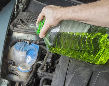 Add up windshield wiper summer fluid in car