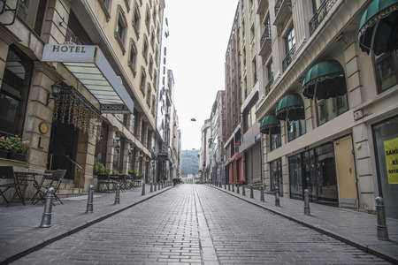 Empty stone street in the city with hotel sign Editorial