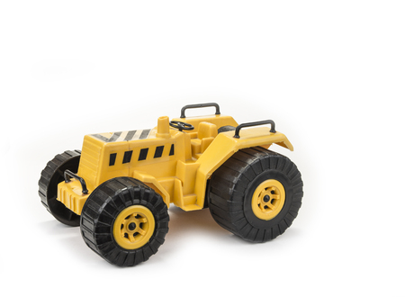 Yellow tractor toy for child on the white background Stock Photo