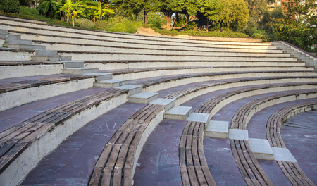 Empty open air theatre with wooden seats