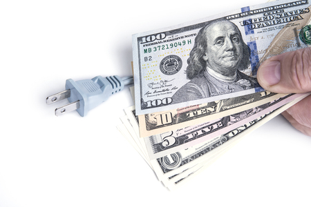 Electric plug with dollar money on the white. Energy save concept