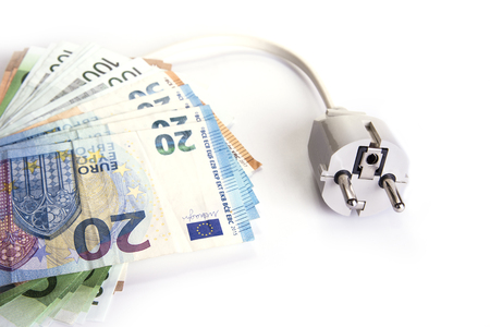Electric plug with euro money on the white. Energy save concept