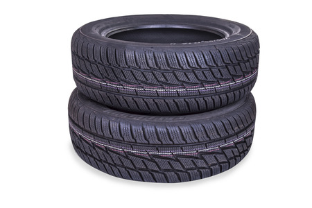 Brand new winter tire isolated on white Imagens