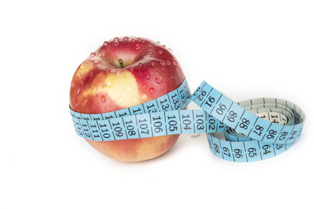 Measuring tape around an apple. Diet and weight loss concept Archivio Fotografico