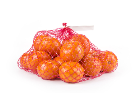 Ripe tangerines  in the net bag on a white background 版權商用圖片