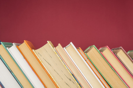 Stack of colorful books. Education and entertainment concept
