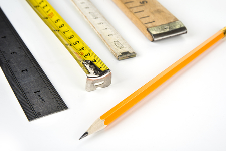 Various meters on a white background with pencil