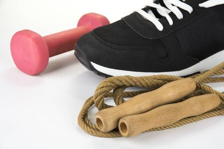 Skipping rope with sport shoe and dumbbell. Healthy lifestyle concept Stock Photo
