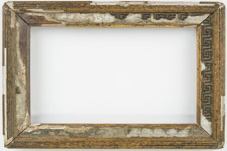 Old vintage rotten empty frame on a white