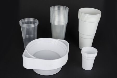 Disposable plastic ware on a black  background