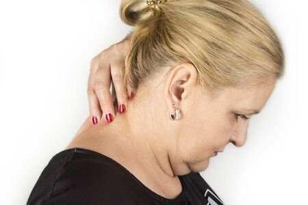 Mature women with neck pain. Self massage concept