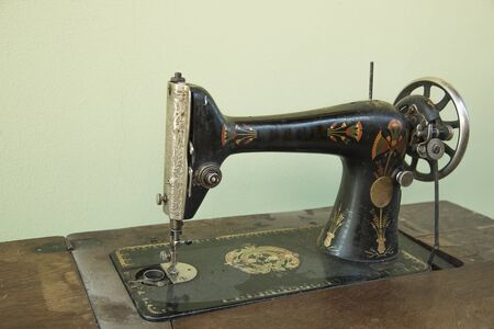 Old metal manual retro sewing machine