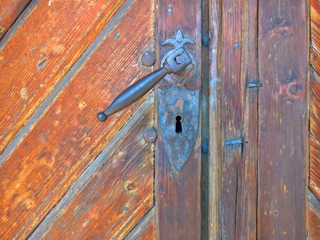 Old metal door with handle and lock Фото со стока