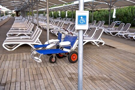 Empty  stretchers on the beach in the summer resort