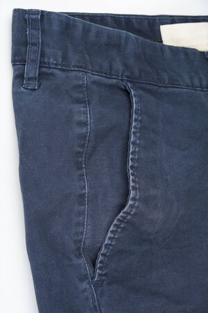 Closeup of male indigo pants on a white