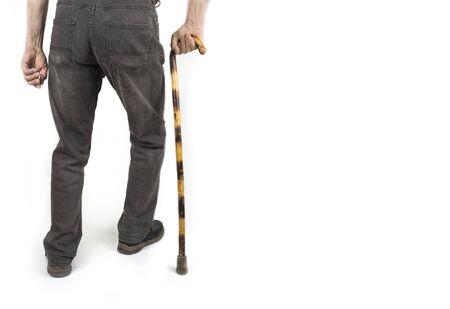 Retired man with cane in jacket on white Zdjęcie Seryjne