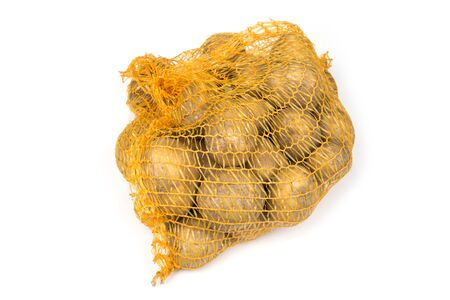 Potato in the mesh net bag on a white