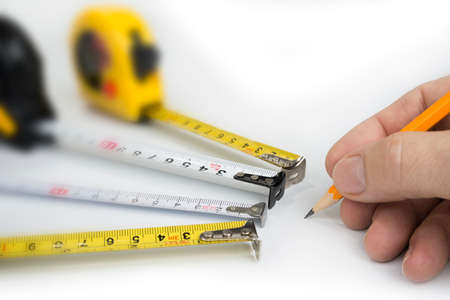 Measure tapes on a white background. Inches and centimeters