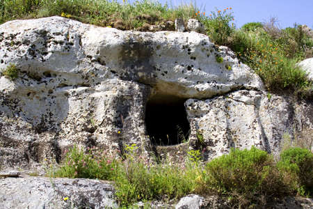 paleolithic: Ancient prehistoric grave in the Sicilian hinterland.  Castelluccio prehistoric village. Stock Photo