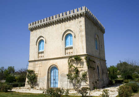 An ancient renaissance tower in the sicilian hinterland photo