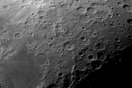 Lunar craters in a telescope image.