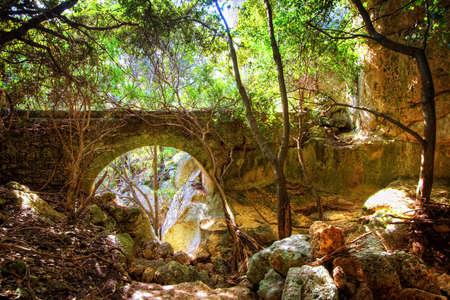 Very old bridge in the wood. Sicilian hiterland, Syracuse, Italy