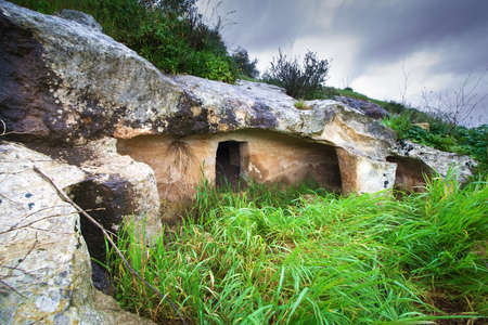 A monumental prehistorich tomb in the sicilian land. It is a very old sepulchre with column.