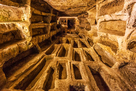 This image represent the large catacomb Larderia in Ragusa country, Sicily. Фото со стока