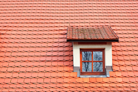 Red shingles on the roof with window
