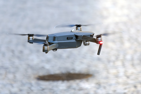 Quadcopter takes off from the pavement Banco de Imagens