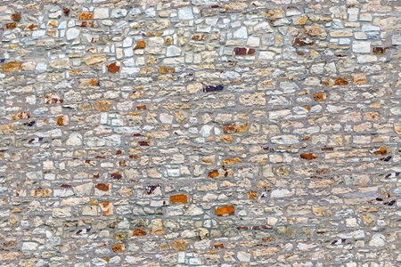 Seamless texture old gray stone wall