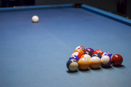 White billiard ball lying on the front of the Pool ball set