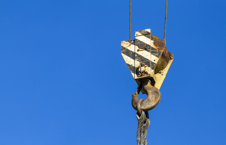 Hook construction crane on blue sky background