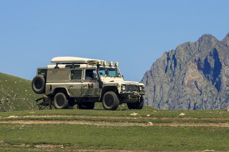 Georgia, Kazbek mountains, 20.08.2018: Vehicle Land Rover Defender is doing off-road trail in Kazbek mountains Editorial
