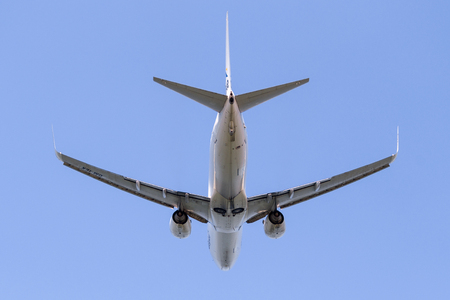 Aircraft with landing gear on the background of the sky Фото со стока
