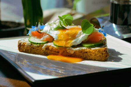 Smorrebrod, Danish Open Sandwich with Smoked Salmon, square with poached egg Stock Photo