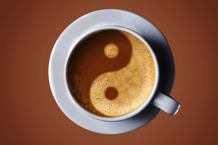 Cup of coffee on black background. Picture of the yin-yang in the coffee crema. top view. coffee in the form of Yin Yang top view