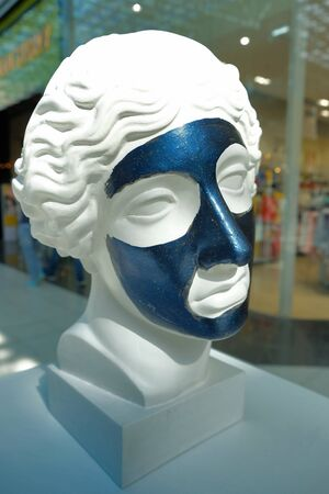 White bust of young woman in the Mall. dark face mask Banque d'images - 129110331