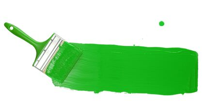 Paint Brush Stroke Across Page with bright green paint. Isolated on White Background.