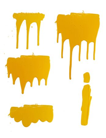 options flowing yellow paint on a white background. isolate. close up of paint leaking down