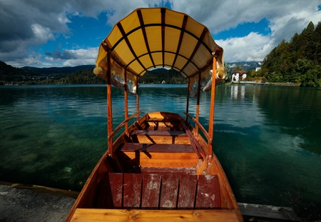 wooden boat at lake bled in the summer