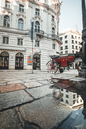 beautiful old street paved with stones and old buildings on a spring day in Vienna Europe Austria