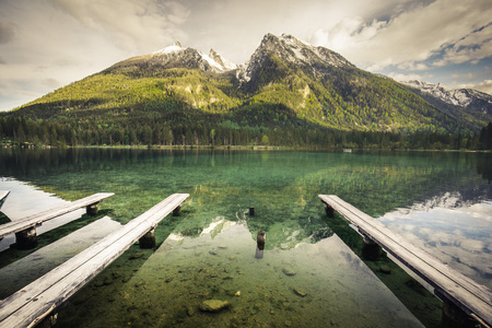 Colorful summer sunrise on the Hintersee lake with white pleasure launches. Sunny morning scene in Austrian Alps. Salzburg-Umgebung, Austria, Europe.